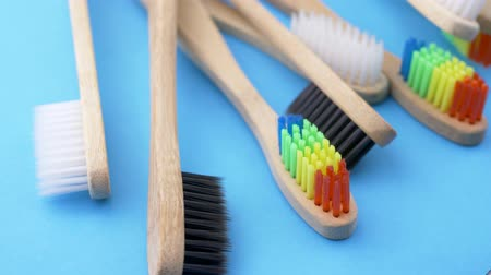 carie : Bamboo toothbrushes on blue background. Bathroom accessories concept