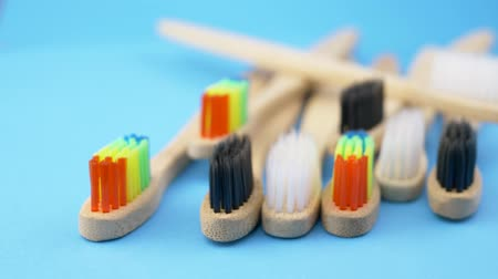 carie : Set of toothbrushes on blue background. Concept bamboo ecofriendly bathroom dental accessories