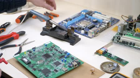 soldering iron : Workplace with electronic components in electronics workshop. Repair Shop and Electronic Devices Concept