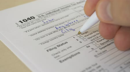 refund : Tax document for the IRS Income U.S. Individual 1040 Tax Return form on wooden table in office or at home Stock Footage