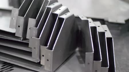 сталь : Metal parts after cutting and bending process on industrial manufacture Стоковые видеозаписи