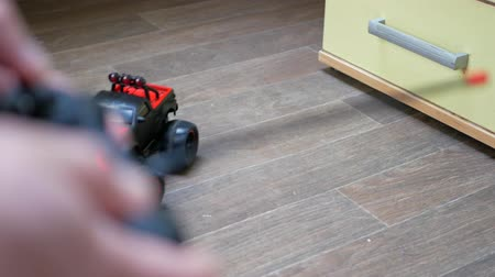 alıcı : Controling the toy car with a remote control in office. Relaxation at work concept