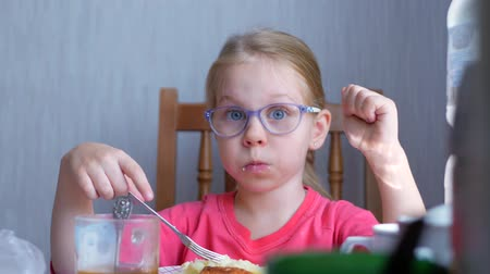 пюре : Little beautiful cute girl doesnt want eating a mashed potatoes at the table in the kitchen