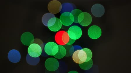 Defocused bokeh lights background. Abstract sparkles Stok Video