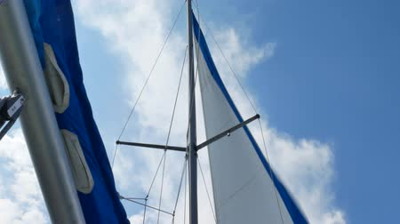 Sails of the sailing yacht in the wind day with blue sky with white clouds background