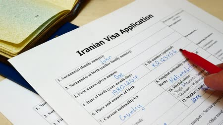talep : Decision to refuse to grant Iranian Visa. Approved in Application form with passport and pen. Document with passport, apply and permission for foreigner country