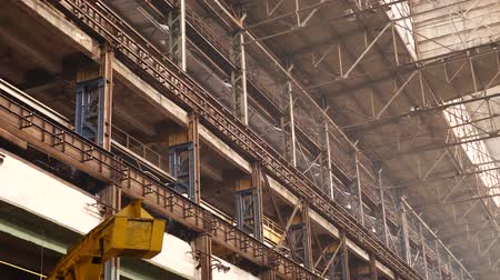 truss : Old industrial hall with metal beams under ceiling in large heavy plant