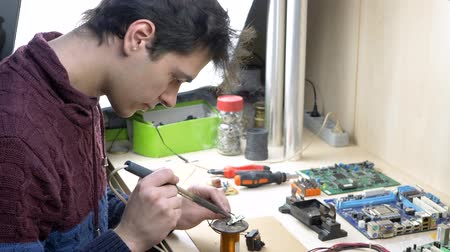 mikroişlemci : Student repair of electronic devices, tin soldering parts in electronics workshop