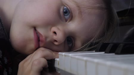 hate : Boring Little Girl Playing Piano Keyboard at Home Stock Footage