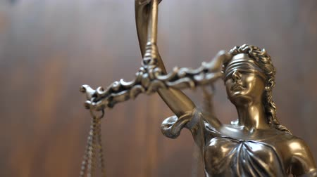 tribunal : The Statue of Justice on Wooden Background. Concept of legal law, advice and justice Stock Footage