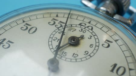 cronômetro : Analogue metal stopwatch on the blue background. Concept of successful business or teamwork Stock Footage