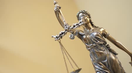 tribunal : The Statue of Justice on Yellow Background. Concept of legal law, advice and justice