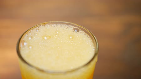 lemoniada : Carbonated soda drink with bubbles and ice on brown background. Summer drink concept
