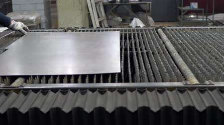 grawerowanie : Worker puts a sheet of steel on CNC laser machine on metalwork manufacture Wideo