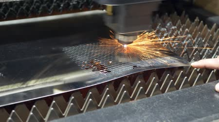 metal işi : Process of industrial laser cutting with sparks of sheet metal on industrial manufacture. Metal cutting or lathe work concept Stok Video