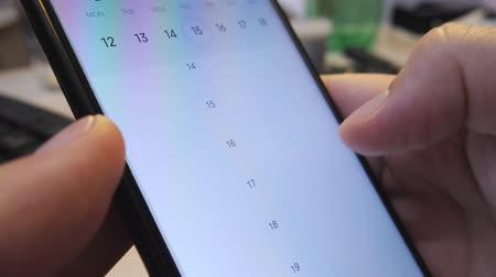 disoccupazione : Blank calendar with blank cases for a few months on a smartphone. Concept of unemployment, free time or job search Filmati Stock