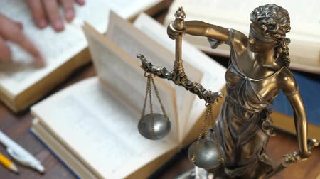 attorney : The Statue of Justice. Lawyer working with papers and law books in courtroom or office. Concept of attorney or court judge, justice and law