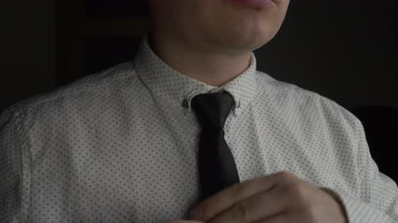 gravata : Unrecognizable Manager or Businessman in White Shirt Wear Dark Blue Tie in Office Stock Footage