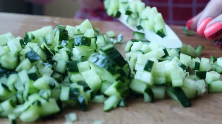 다진 것 : Chef female slices green ripe cucumber in kitchen at home preparing vegetable salad