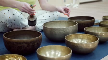 gong : Woman with tibetan singing bowl. Music therapists, sound healers and yoga practitioner concept