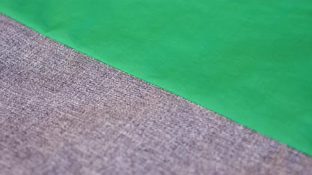 samples of fabric : Green gray fabric cloth texture for background. Fashion designer at tailor working studio concept
