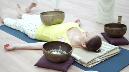 singing bowl : Music therapists, sound healers and yoga practitioner concept. Struck and singing bowls are widely used for music making, meditation relaxation, as well for personal spirituality Stock Footage