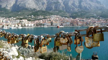 loajální : View at love padlocks with mediterranean city background Dostupné videozáznamy