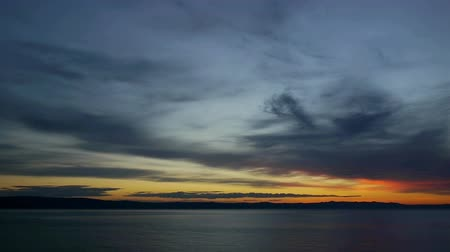 serene : Sunset at calm sea and cloudy sky on Adriatic sea coast