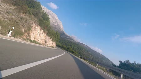 lovas : Driving motorcycle on the road close to the sea in Croatia POV