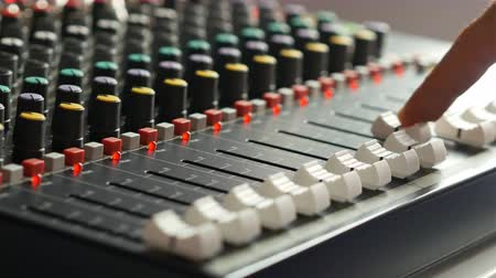 painel : Man working on audio mixer board in music studio indoors close up