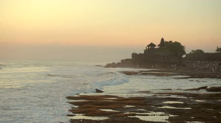 azevinho : Tanah Lot temple and sea waves in beautiful sunset light, Bali, Indonesia Stock Footage
