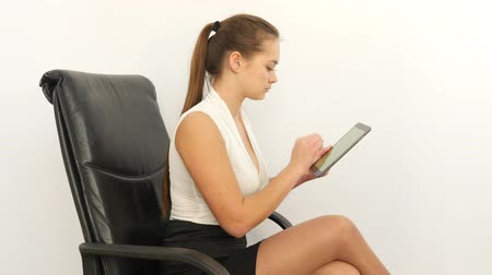стулья : Business Woman Taping on Tablet and Feels Pain in Neck Стоковые видеозаписи