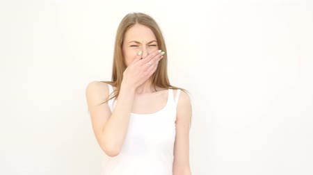unpleasant smell : Girl Feels an Unpleasant Smell