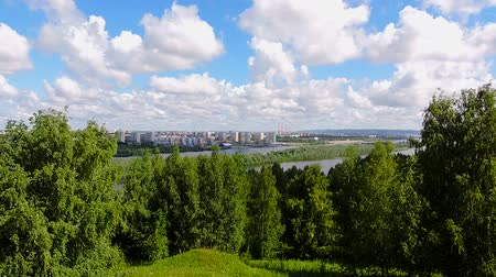 Time lapse, Beatiful landscape, clouds floating above the city, swinging trees