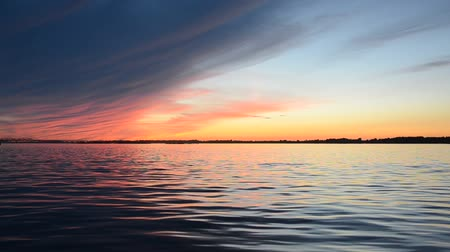 лодки : Beautiful summer sunset on the river reflection of the sky on the water surface