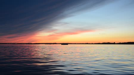 nedves : Beautiful summer sunset on the river reflection of the sky on the water surface