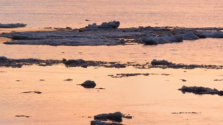Ice floe floats in water, fragments of ice on the river in spring, ice drift