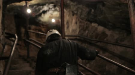 career path : Miner going into mine up stairs