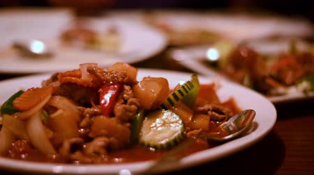 white onion : Traditional Thai Stir-Fry on a white plate, tracking shot