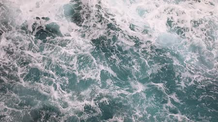 Deep blue stormy sea water surface with white foam and waves