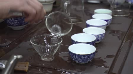 bule : A woman is preparing for a tea ceremony. The Chinese tea shop. tea Tasting