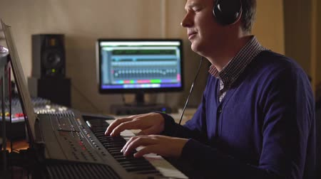 compositor : People in the Studio emotionally composes music