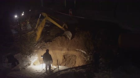 geologia : excavator digs a pit night