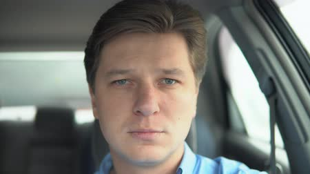 overwrought : Portrait of a sad man in a car.