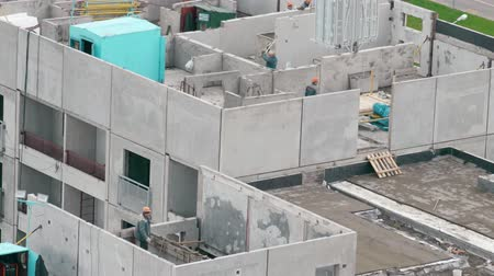 constructing : Builders build a multi-storey house Stock Footage