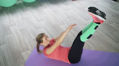 gymnastics : Young woman doing exercises for the press. Stock Footage