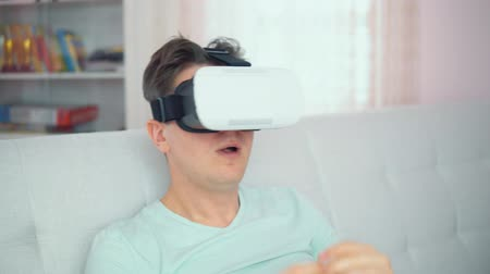 A young man with glasses of virtual reality In a bright interior Wideo