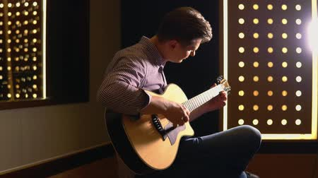 Man playing guitar in studio