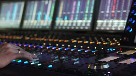 showbiz : A man works in a recording studio on a mixing console. Hands close up Stock Footage