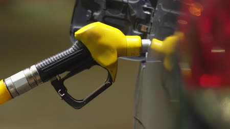 Refueling car. Gasoline pump close up